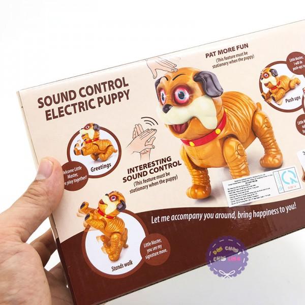 Hộp đồ chơi chó mặt xệ nhảy cảm ứng mắt đèn dùng pin 0550