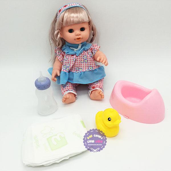 Hộp đồ chơi em bé ngậm bình sữa ngồi bô dùng pin có nhạc