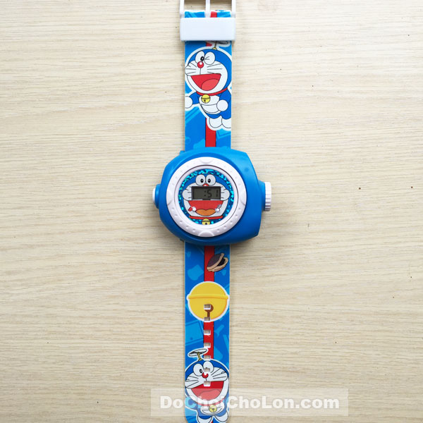 Vỉ đồ chơi đồng hồ Doraemon chiếu hình ảnh lên tường